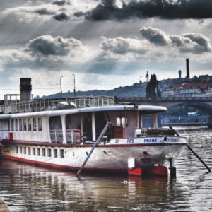 Souvenirs from Prague Boat on the river in Prague photo 3